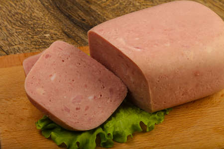 Ham sausage over salad leaves ready for eat Stock Photo - 88707239
