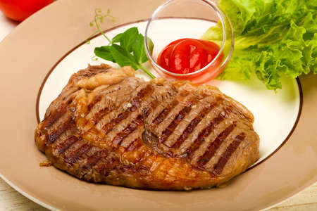 Grilled Rib eye steak with sauce Stock Photo