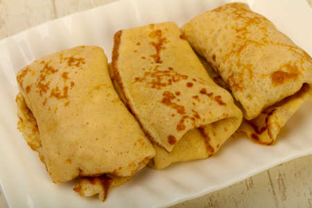 Homamde pancakes with meat in the table