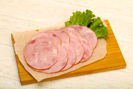 Sliced sausage with salad leaves Stock Photo - 90502638