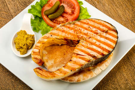 Grilled salmon with tomato, cucumber over the pita bread