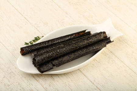 Asian cuisine - Nori chips over the wooden background