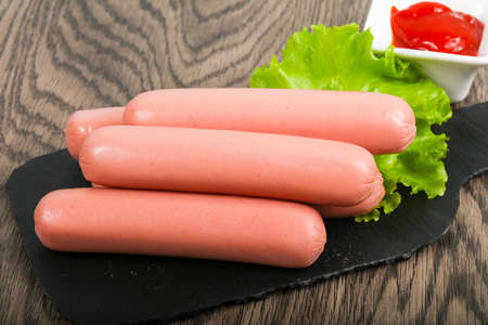 Boiled Sausages with salad and ketchup Standard-Bild
