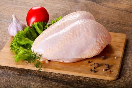 Raw chicken with skin