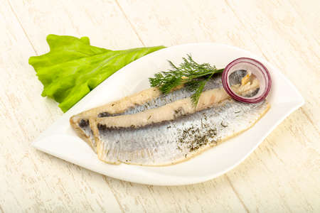 Herring fillet with dill and onion Stock Photo