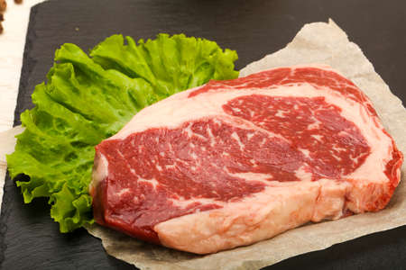 Rib eye raw steak ready for cooking Stock Photo