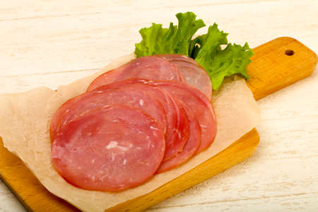 Sliced sausage with salad leaves Stock Photo - 92252803