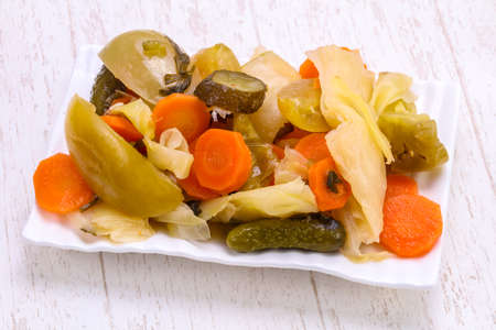 Pickled vegetables mix in the bowl 스톡 콘텐츠