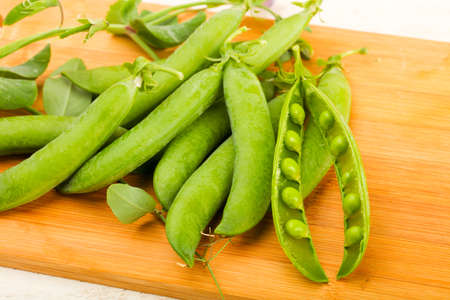 Ripe green peas with leaves