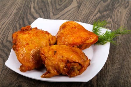 Roasted chicken thigh with tomato sauce Stock Photo