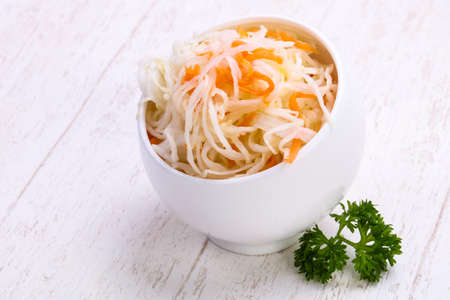 Traditional fermented cabbage sauerkraut in the bowl