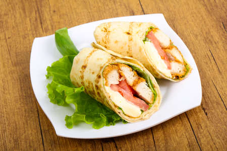 Chicken bread roll with salad leaves