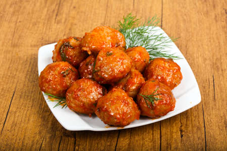 Meat balls in tomato sauce served dill