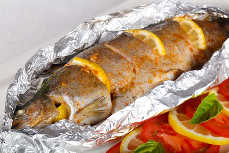 Roasted trout with tomato and lemon