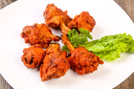 Indian traditional cuisine - Chicken lollipops with spices 스톡 콘텐츠
