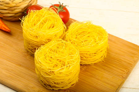 Raw fettucine pasta ready for bowling Stock Photo