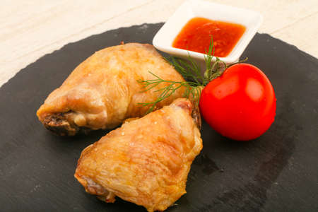 Baked chicken leg with tomato