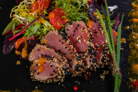 Tuna carpaccio with sauce and spices Stock Photo