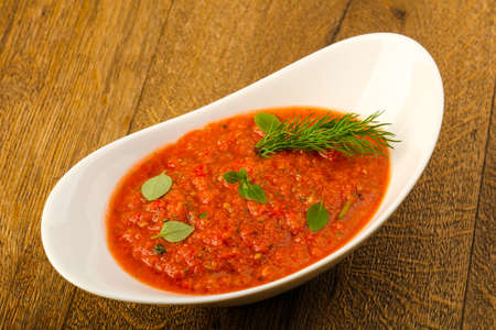 Tomato Gazpacho soup with dill and basel leaves Stock Photo