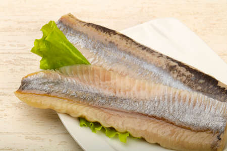 Herring fillet over salad leaves - ready for eat Banco de Imagens