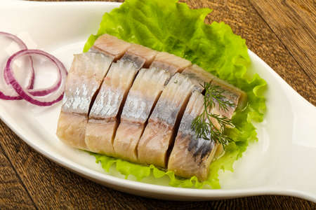 Sliced Herring fillet with dill and onion 스톡 콘텐츠