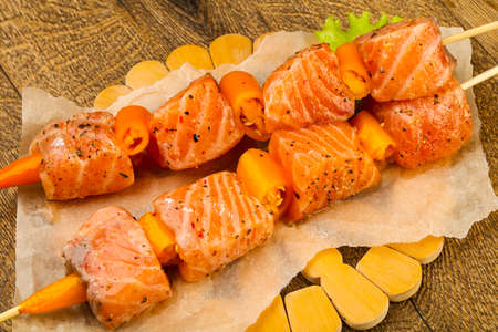 Raw salmon skewer with spices ready for cooking Stock Photo