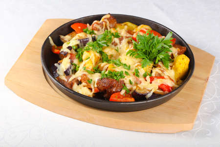 Pork with vegetables and cheese Stock Photo
