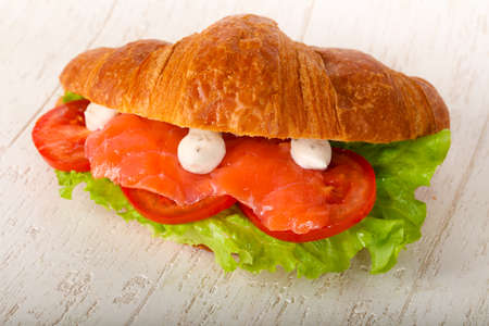 Croissant with salmon and cream sauce