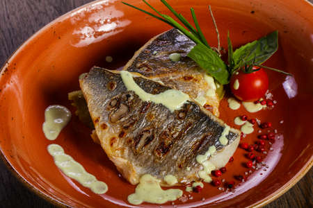 Grilled dorada fillet served tomato and onion