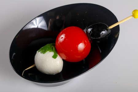 Canape with tomato and mozarella cheese