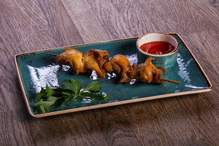 Chicken skewer with sauce and parsley Stock Photo