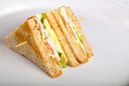 Club sandwich with meat, cheese and vegetables