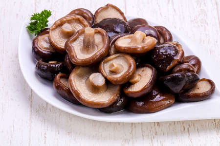 Pickled mushrooms in the bowl with spices Stock fotó - 100711105