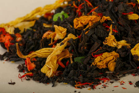 Aroma tea heap with fruit, berries and herbs