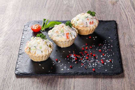 Russian salad canape with herbs