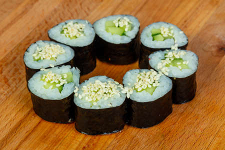 Maki with cucumber and sesam seeds