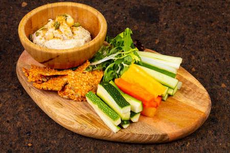 Delicious humus with pepper, cucumber and zuccini Standard-Bild