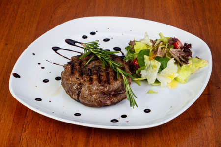 Delicious fried beef stake with salad