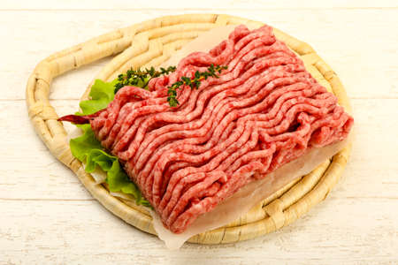 Raw minced beef meat with thyme and hot pepper