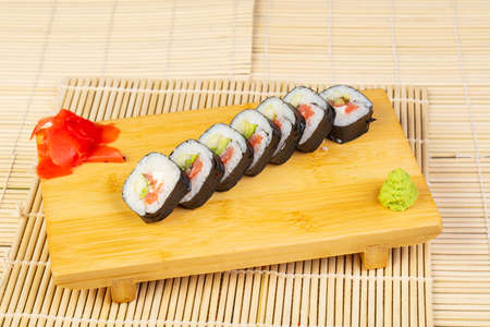 Delicious spicy sushi rolls with prawns Stock Photo