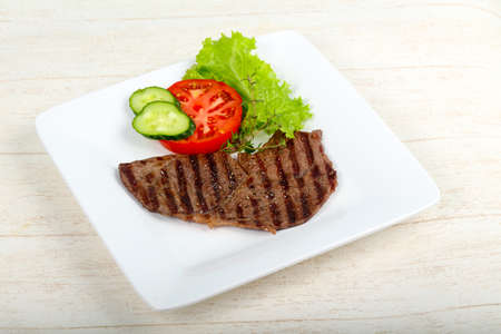 Grilled beef steak with sauce and thyme