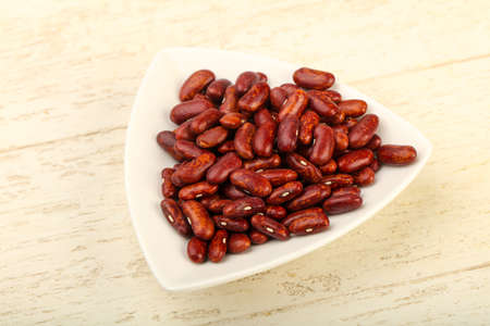 Dry beans in the bowl over wooden background Stock Photo