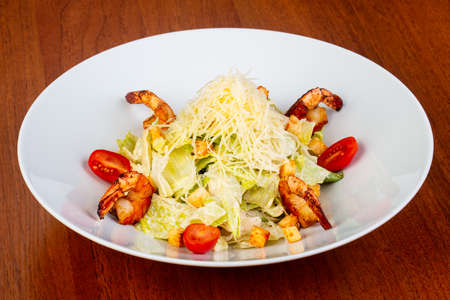 Delicious ceasar salad with fried shrimps