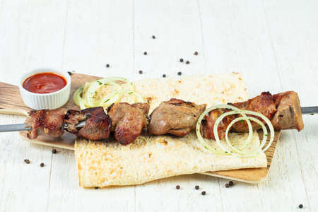 Grilled pork kebab with onion and sauce Archivio Fotografico - 103407486