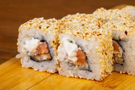 Tasty Alaska rolls with sesame Stock Photo