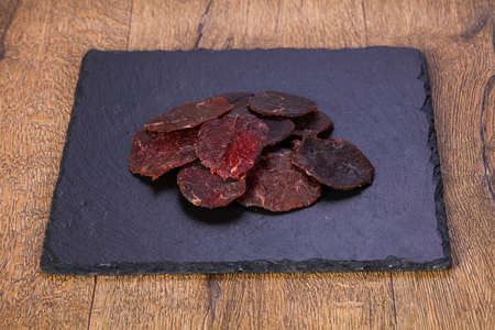Dry beef meat over wooden