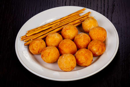 Delicious cheese balls with breadsticks