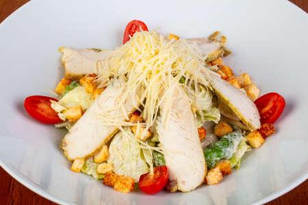 Tasty caesar salad with chicken