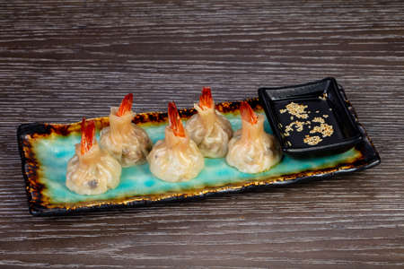 Delicious dim sum with shrimps and sauce