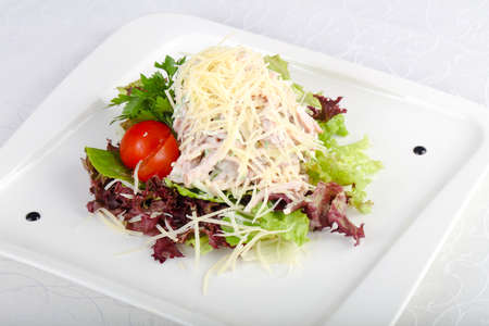 Salad with ham and parmesan cheese